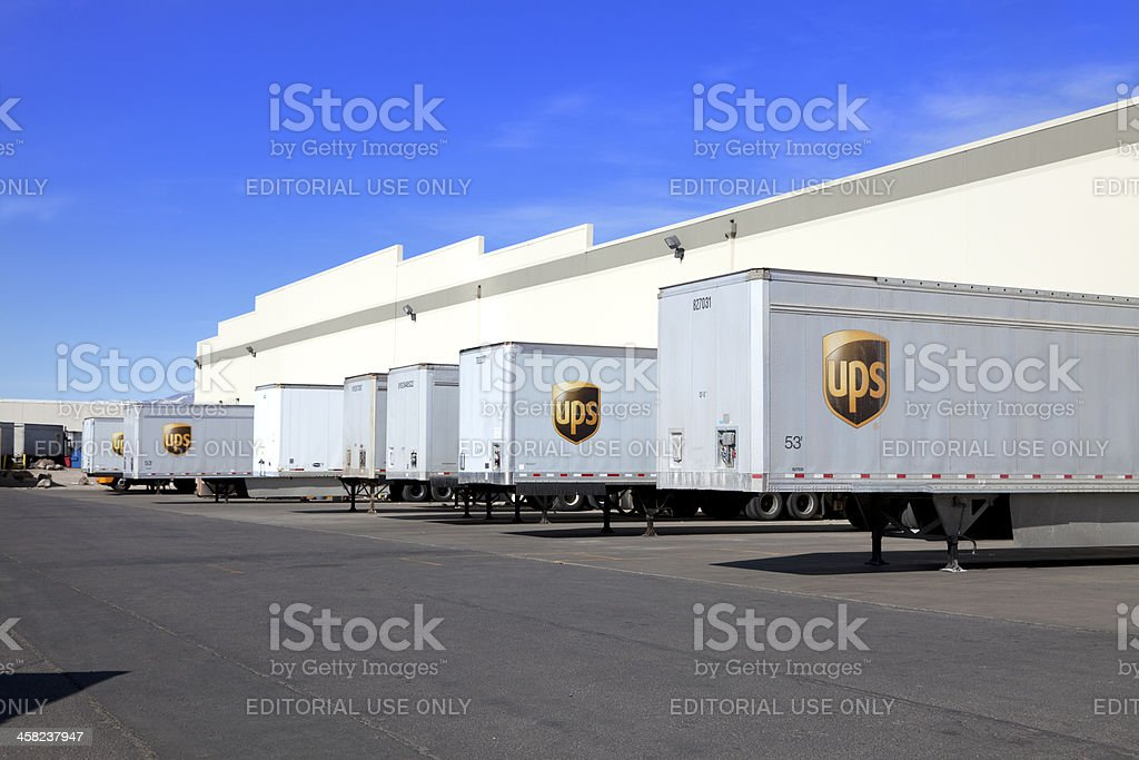UPS Semi Trailers Lined Up at Warehouse royalty-free stock photo