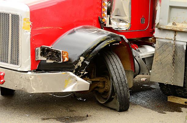 Semi truck accident wheel bent stock photo