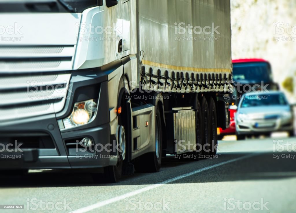 Semi Truck and the Traffic stock photo