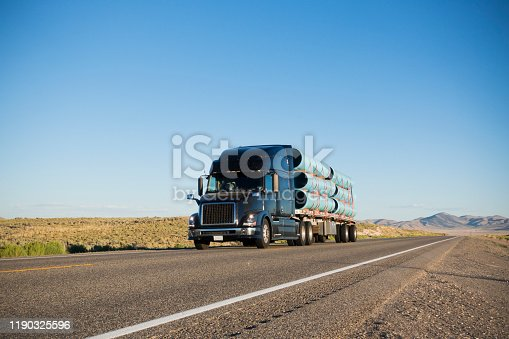 Semi Truck Carrying Construction Materials on Highway