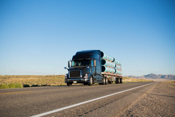 Semi Truck Carrying Construction Materials on Highway stock photo