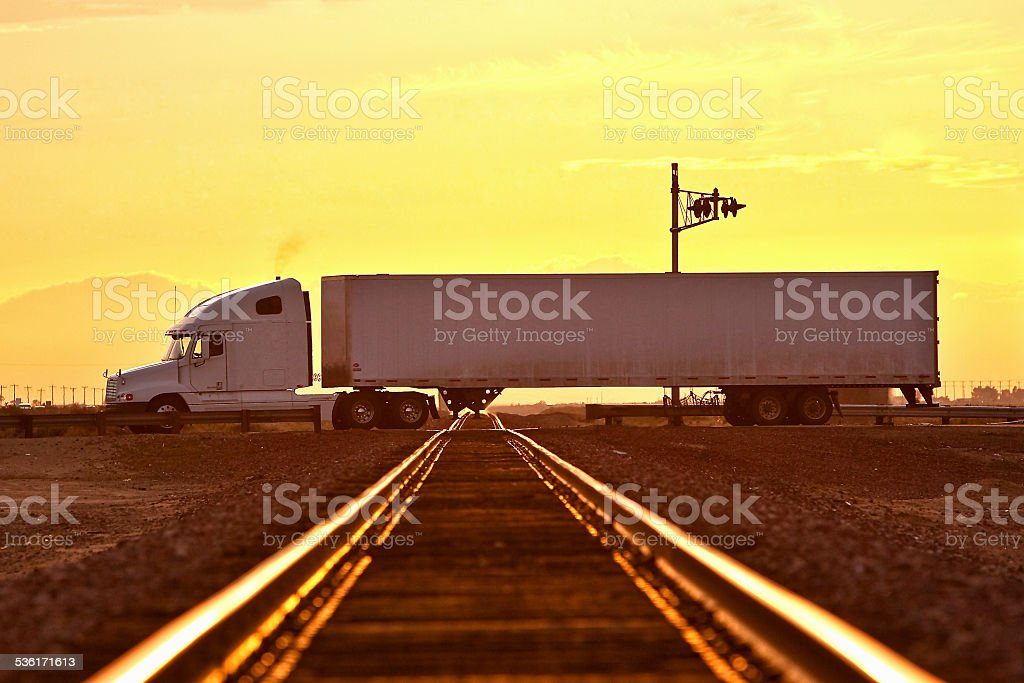 semi truck drives over rail way stock photo
