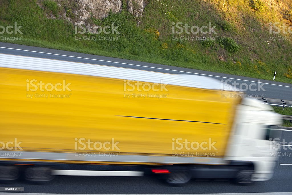 Semi Truck Driving on Highway, Blurred Motion royalty-free stock photo