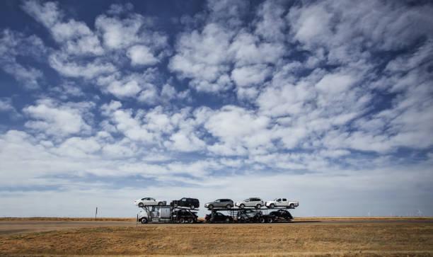 Semi truck hauling vehicles stock photo