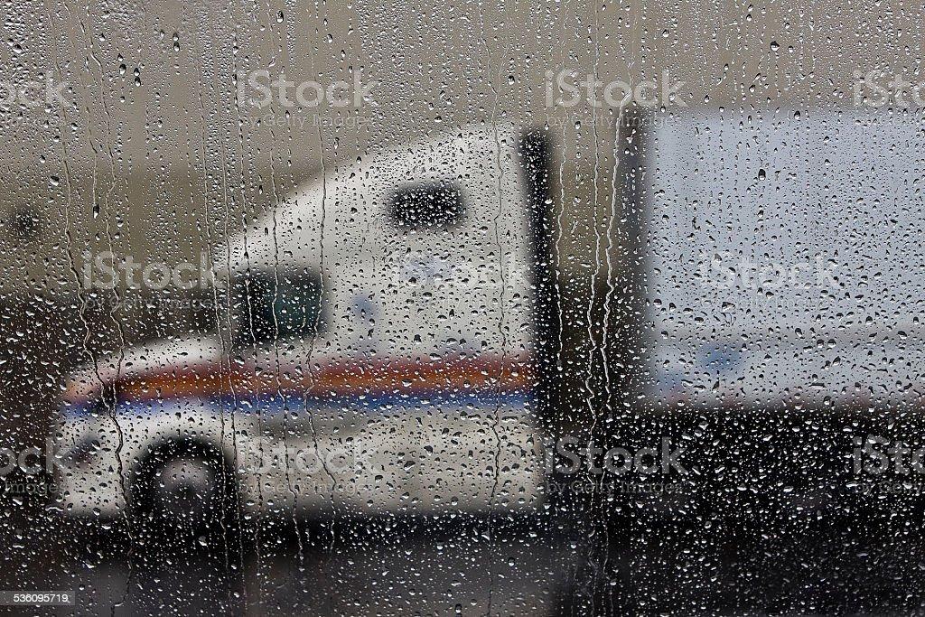semi truck in the rainy windshield stock photo