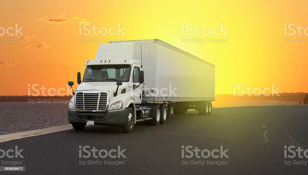 Semi Truck in the sunset stock photo