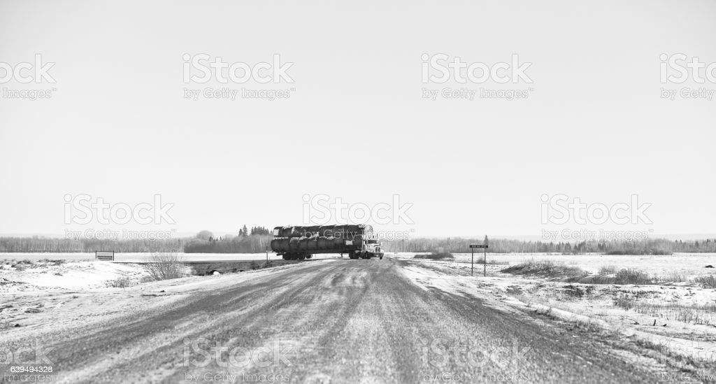 Semi truck loaded with round bales stock photo