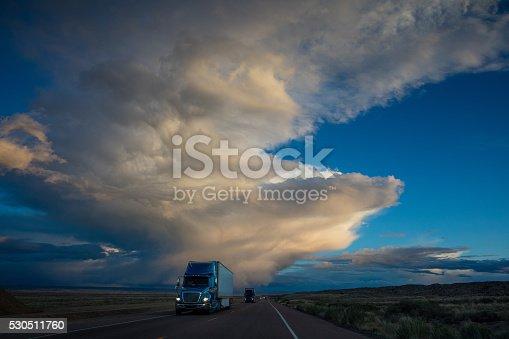 istock Semi Truck on American Highway Dramtic Twilight Sky 530511760