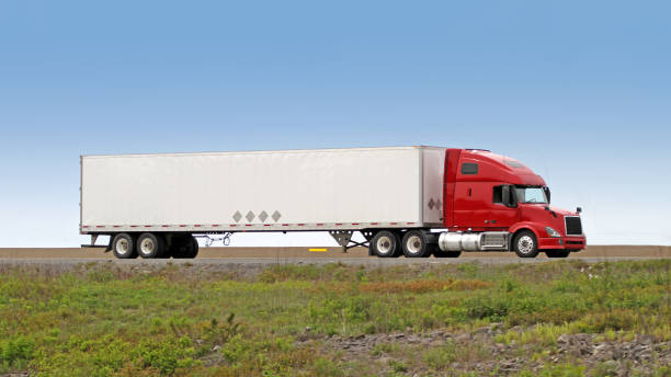 Semi Truck On Interstate Delivering Its Load stock photo