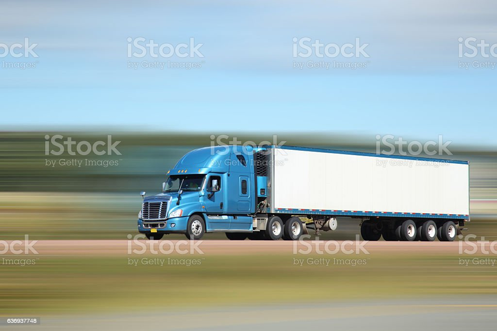 Semi truck on interstate, lots of motion blur stock photo