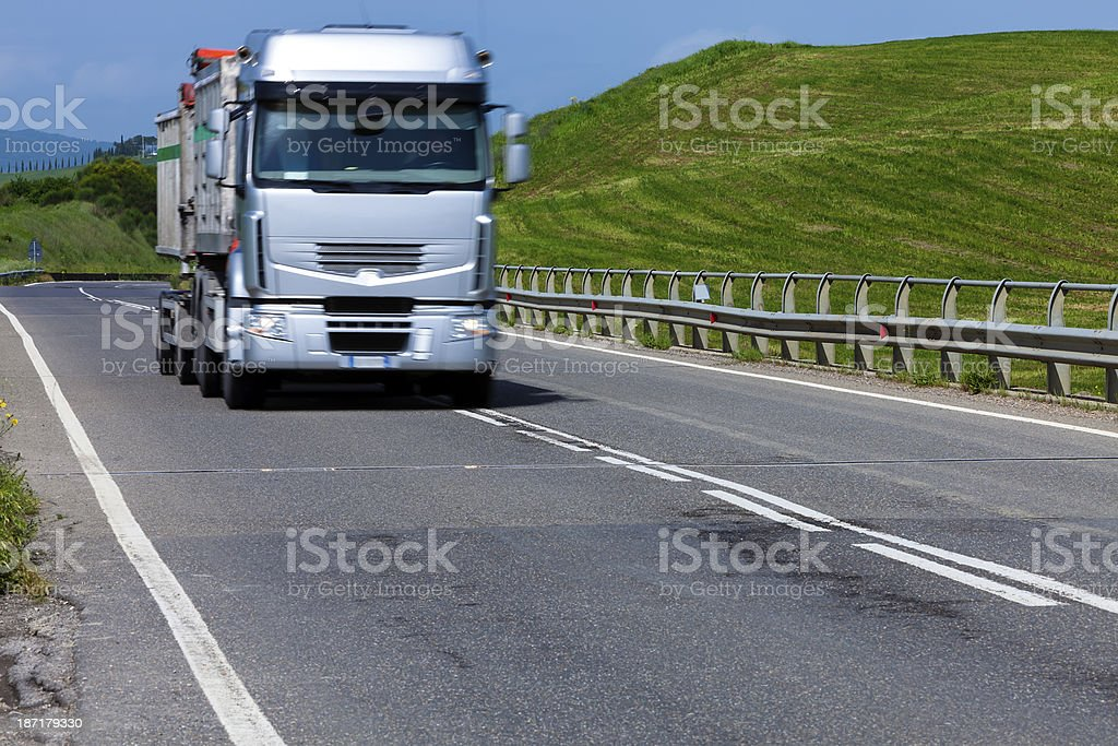 Semi Truck on Rural Highway, Tuscany, Italy royalty-free stock photo