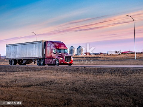 Semi Truck On the  Rural Trans-Canada Highway at sunset.
