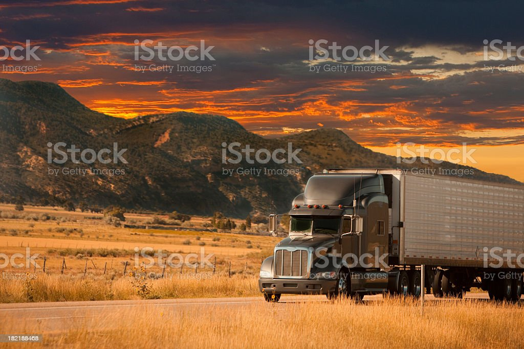 semi truck sunset stock photo