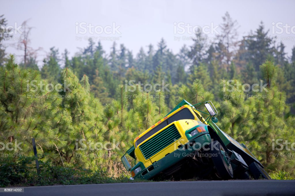 Semi truck tipper pulled off the road in ditch and waited for a towing stock photo