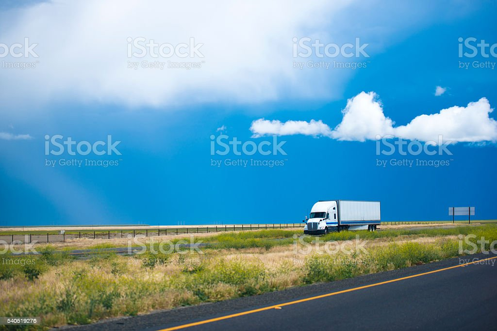 Semi truck trailer moving road with awesome landscape in California stock photo