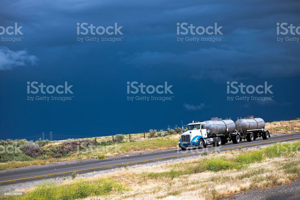Semi truck with two tanks trailers on California road stock photo