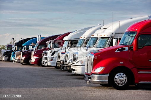 Group of semi trucks parked at truck stop, American transport concept, Missouri, United States.