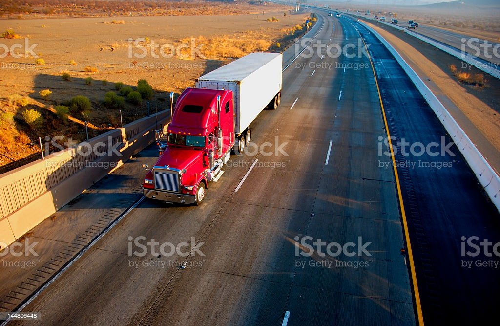 Semi with red cab on deserted highway in sage country  royalty-free stock photo