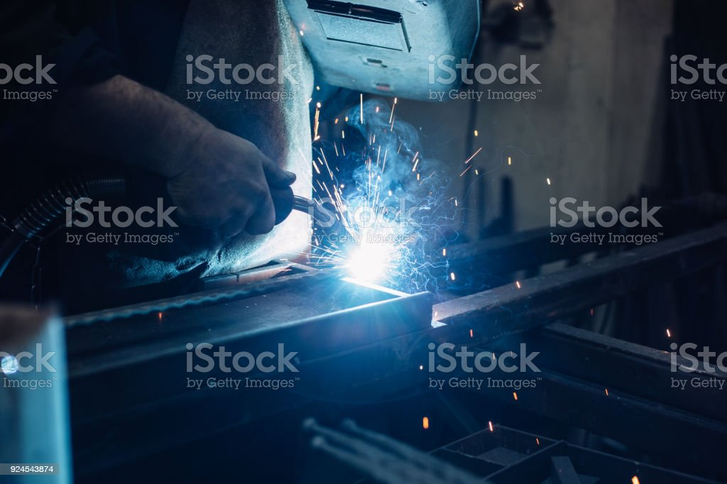 Semi-automatic welding with sparks and smoke stock photo