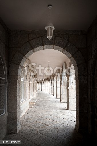 Old College of orphans with the arches in the foreground of the entire corridor