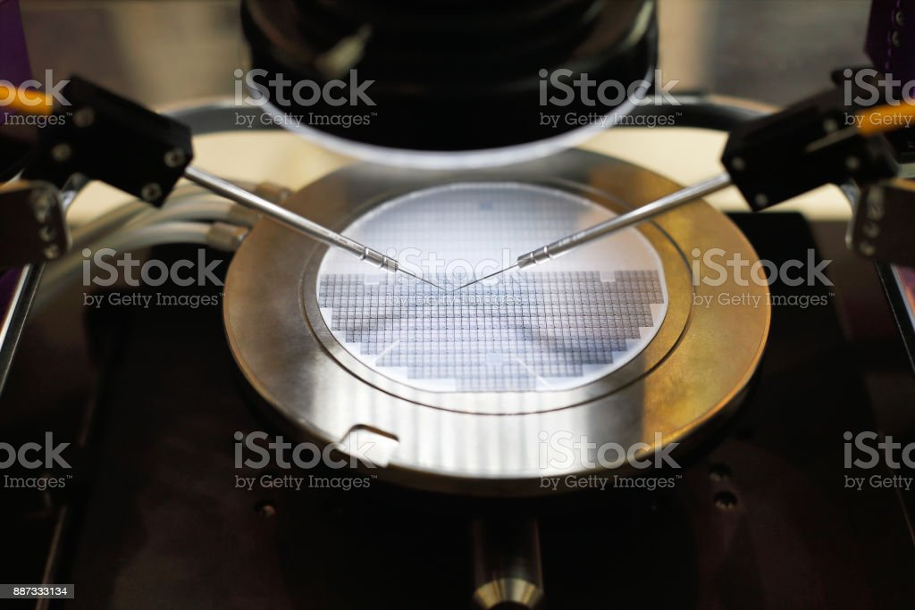 semiconductor silicon wafer undergoing probe testing stock photo