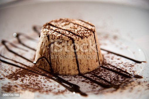 Semifreddo with walnut and chocolate sause in a restaurant.