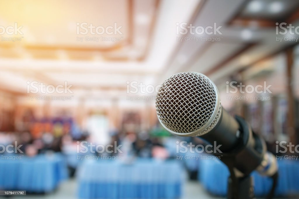 Close-up Microphones on abstract blurred of speech in meeting room,...