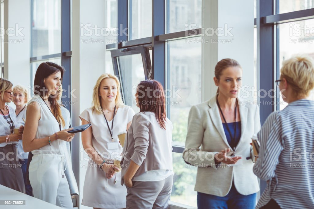 Seminar for woman, women discussing during coffee break stock photo