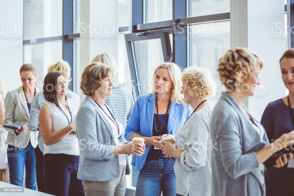 Seminar for woman, women discussing during coffee break Women at conference. Group of women discussing during coffee break. Adult Stock Photo