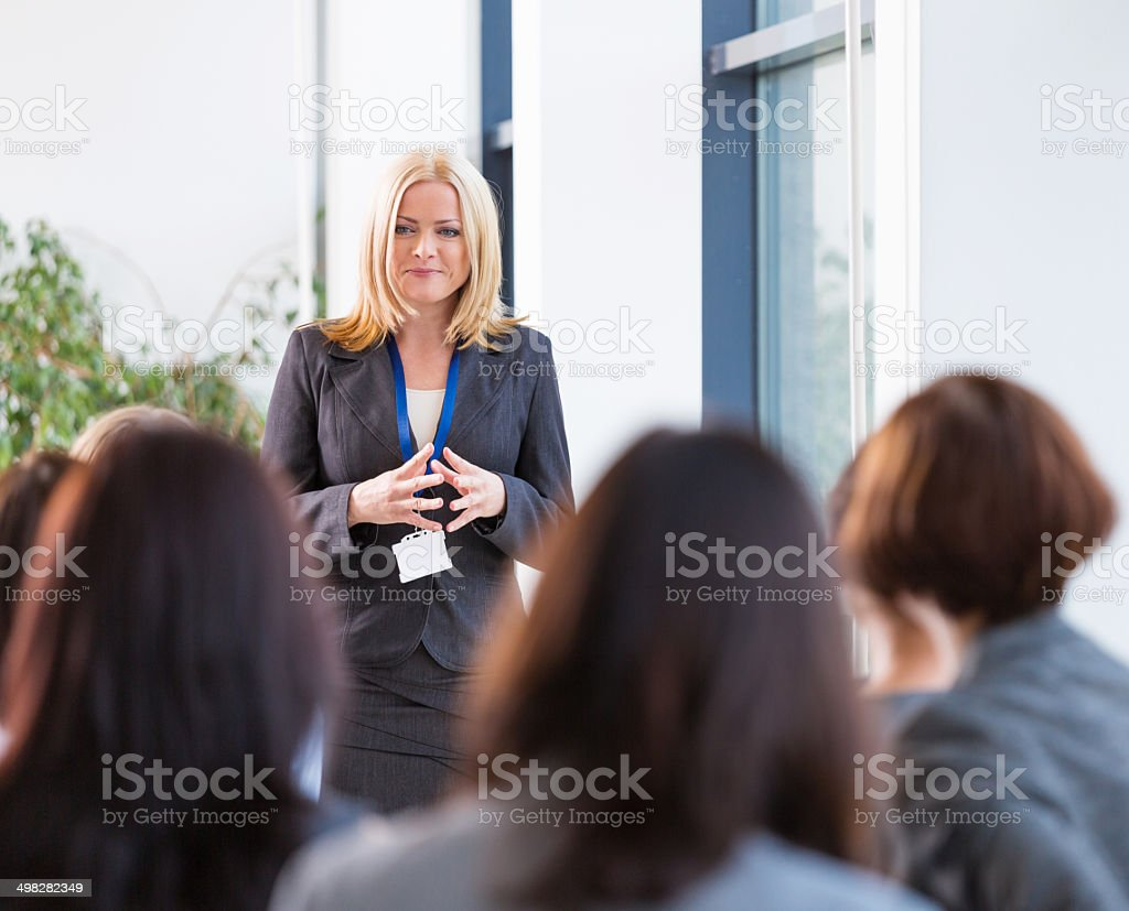Seminar for women Group of businesswomen attending a seminar. Focus on the female coach. 30-39 Years Stock Photo