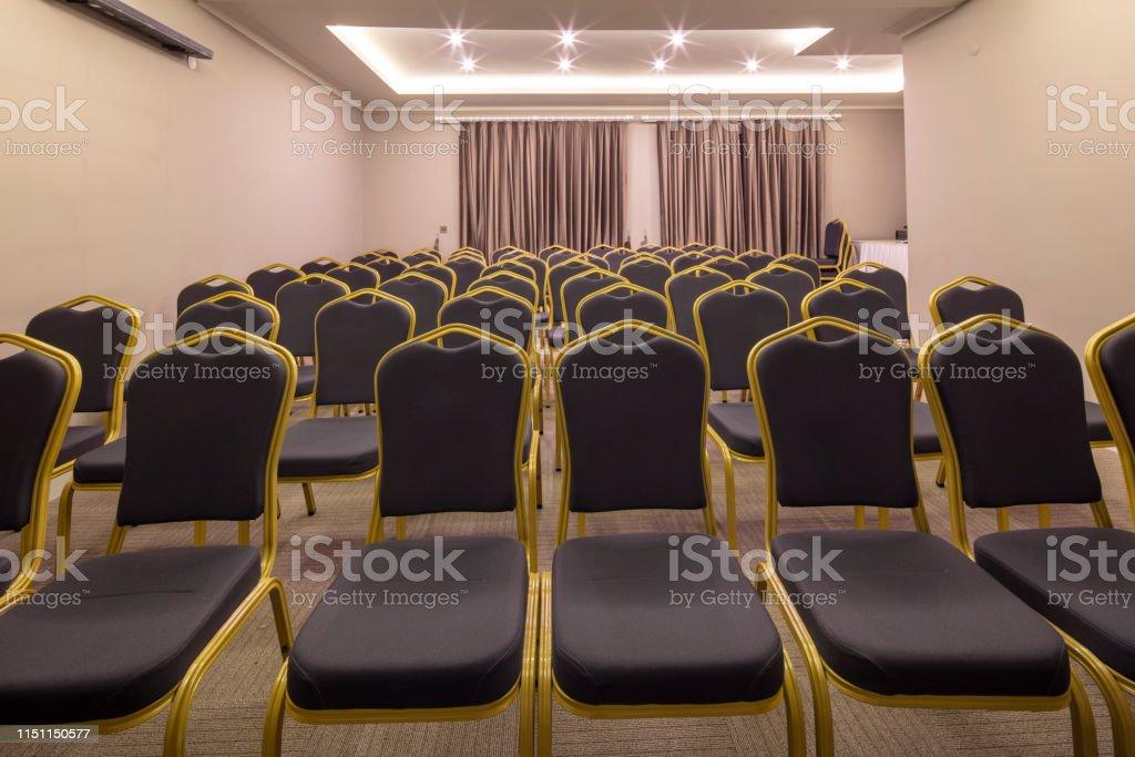 Seminar presentation. Empty conference room, lots of empty seats....