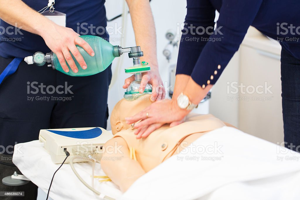 CPR seminar,mechanical ventilation and heart massage of dummy stock photo