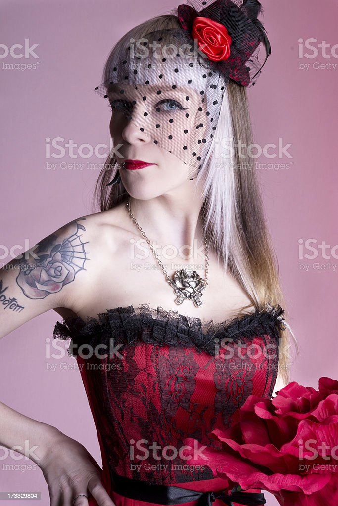 Semi-profile of woman in lace corset on pink. royalty-free stock photo