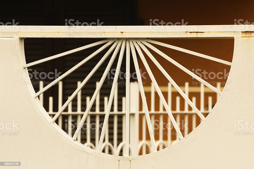 Semi-sphere pattern through a white gate royalty-free stock photo