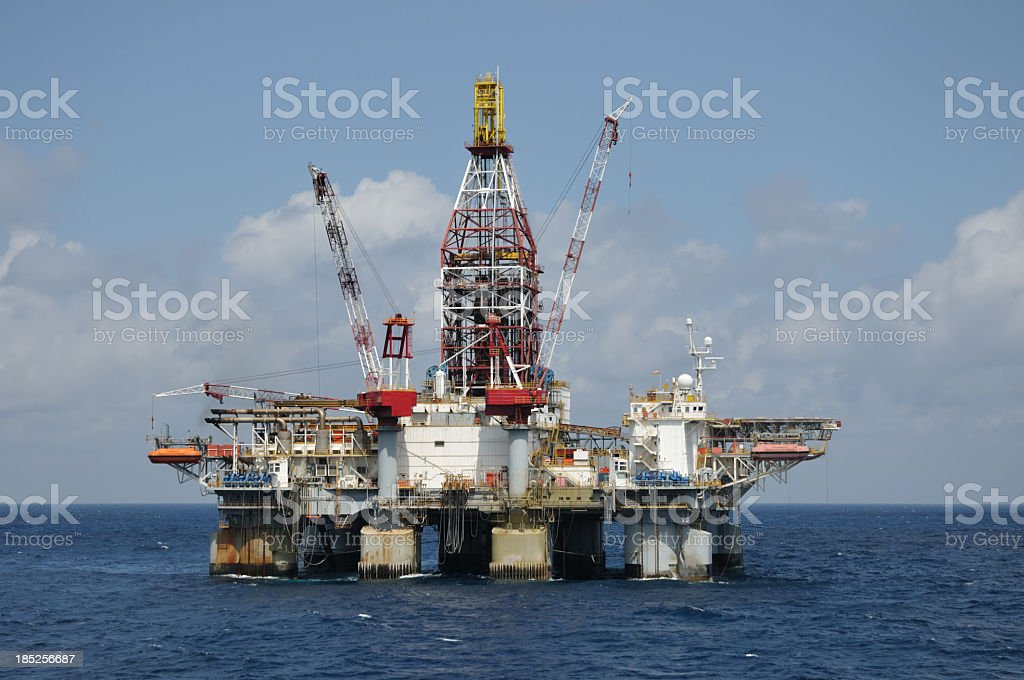 Semi-submersible deep drilling offshore oil rig platform stock photo