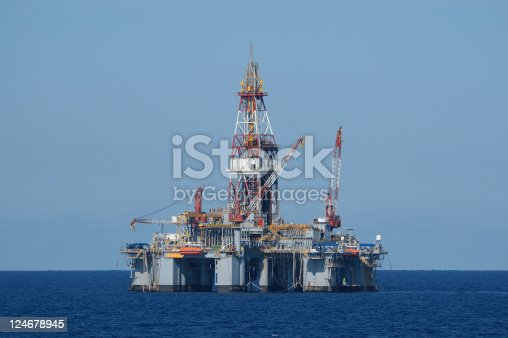 A semi-submersible type deep ocean oil drilling platform.Off shore oil rig. Keywords: Oil Rig, Drilling Rig, Sea, Oil, Oil Industry, Oil Drill, Oil Well, Industry, Natural Gas, Petroleum   [url=file_closeup.php?id=12967574][img]file_thumbview_approve.php?size=1&id=12967574[/img][/url] [url=file_closeup.php?id=12967567][img]file_thumbview_approve.php?size=1&id=12967567[/img][/url] [url=file_closeup.php?id=12223623][img]file_thumbview_approve.php?size=1&id=12223623[/img][/url] [url=file_closeup.php?id=12223604][img]file_thumbview_approve.php?size=1&id=12223604[/img][/url] [url=file_closeup.php?id=10708932][img]file_thumbview_approve.php?size=1&id=10708932[/img][/url] [url=file_closeup.php?id=5641725][img]file_thumbview_approve.php?size=1&id=5641725[/img][/url] [url=file_closeup.php?id=7388628][img]file_thumbview_approve.php?size=1&id=7388628[/img][/url] [url=file_closeup.php?id=8254986][img]file_thumbview_approve.php?size=1&id=8254986[/img][/url] [url=file_closeup.php?id=11324609][img]file_thumbview_approve.php?size=1&id=11324609[/img][/url] [url=file_closeup.php?id=11300094][img]file_thumbview_approve.php?size=1&id=11300094[/img][/url] [url=file_closeup.php?id=11302626][img]file_thumbview_approve.php?size=1&id=11302626[/img][/url] [url=file_closeup.php?id=6592745][img]file_thumbview_approve.php?size=1&id=6592745[/img][/url]  [url=file_closeup.php?id=7390757][img]file_thumbview_approve.php?size=1&id=7390757[/img][/url] [url=file_closeup.php?id=12255127][img]file_thumbview_approve.php?size=1&id=12255127[/img][/url]    [url=http://www.istockphoto.com/search/lightbox/10498378]Over 60 offshore oil rigs in one lightbox[/url]