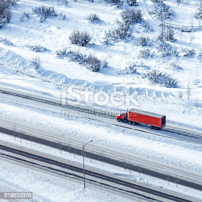Semi-truck with container during winter on a highway in Colorado, USA