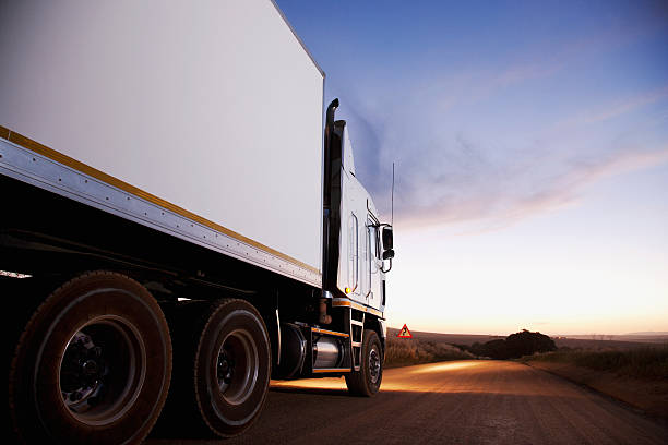 Semi-truck driving on dirt road  commercial land vehicle stock pictures, royalty-free photos & images