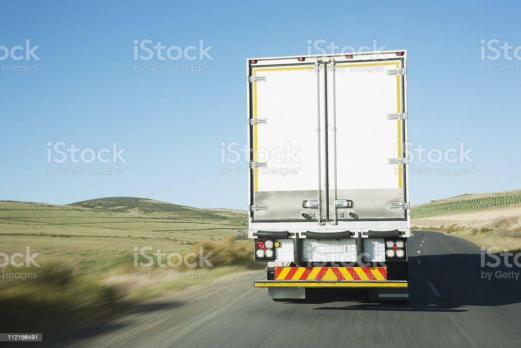 Semi-truck driving on remote rode royalty-free stock photo