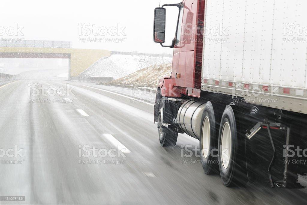 Semi-truck on Snowy Interstate stock photo