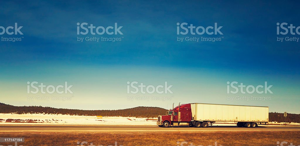 semi-truck on the highway stock photo
