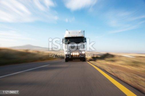 istock Semi-truck speeding on remote road 112156527