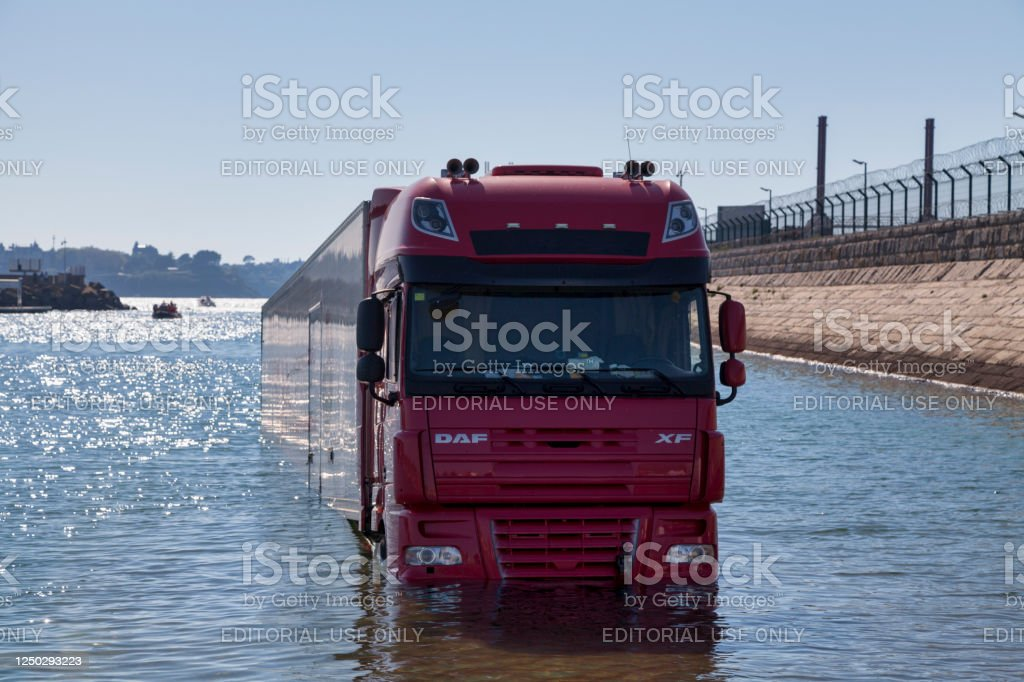 Semi-truck surprised by the rising tide - Royalty-free Brittany - France Stock Photo