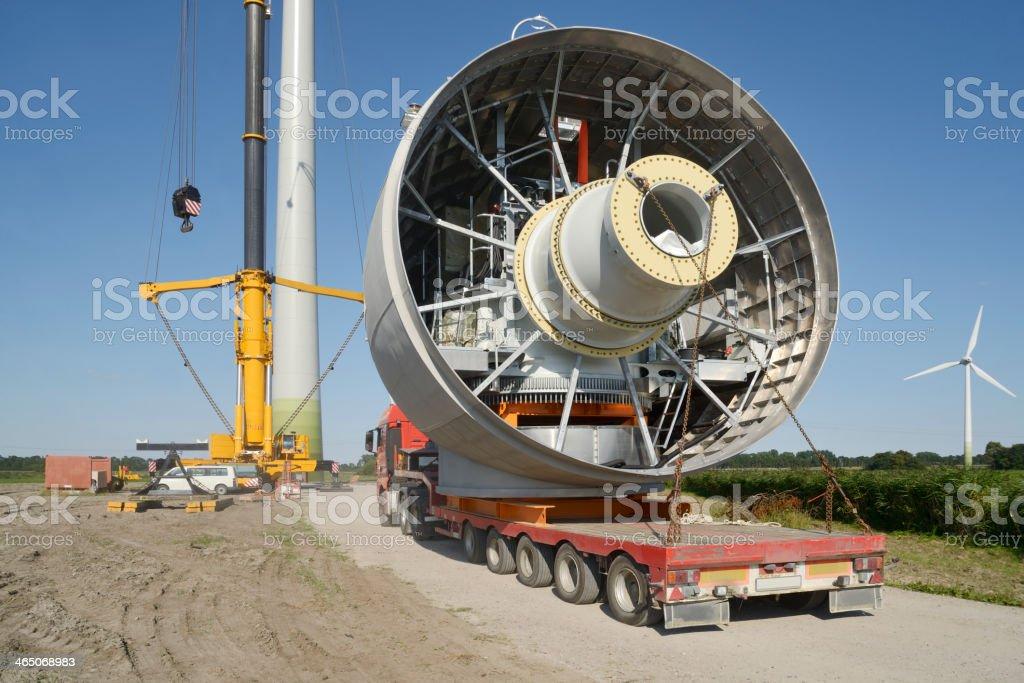 Semi-Truck transporting Gear Equipment of a Wind Turbine stock photo