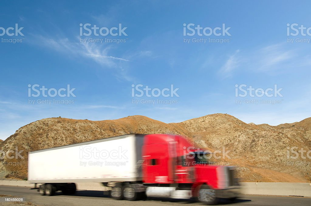 Semi-Truck with Trailer and Tractor on a Highway royalty-free stock photo