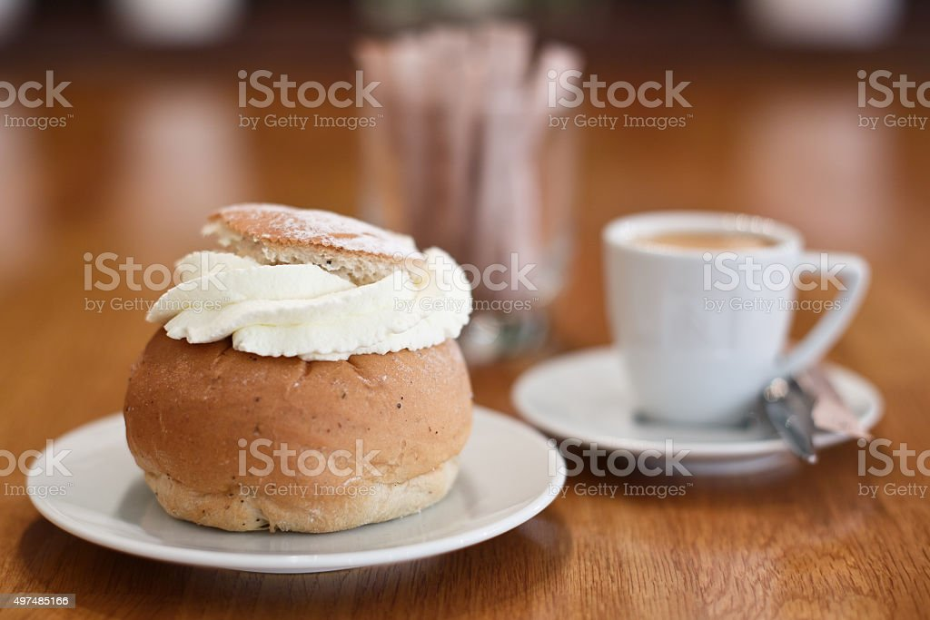 Semla with coffee Traditional Swedish pastry called Semla. 2015 Stock Photo