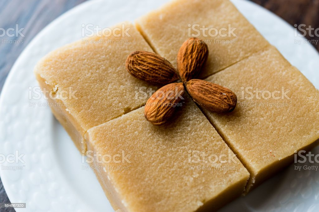 Semolina Halva with Almonds cut in square. stock photo