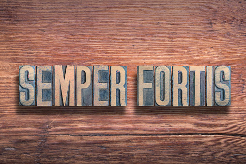 semper fortis ancient Latin saying meaning - always brave, combined on vintage varnished wooden surface