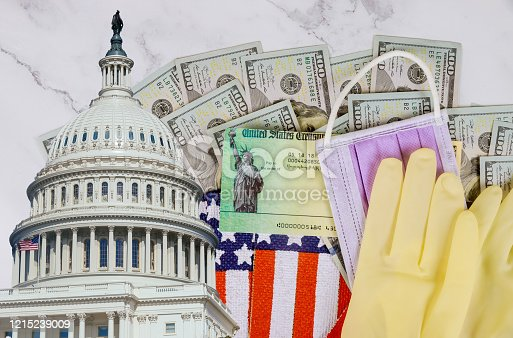 Senate stimulus deal includes individual checks virus economic stimulus plan USA dollar cash banknote on American flag Global pandemic Covid 19 lockdown