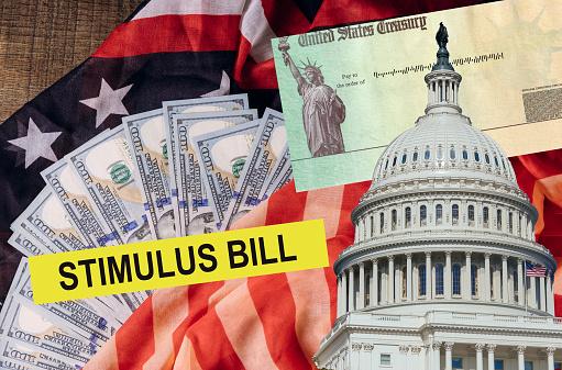Senate stimulus deal includes individual checks virus economic stimulus plan USA dollar cash banknote on American flag Global pandemic Covid 19 lockdown